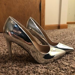 Silver/mirrored pointy toe heels. Never worn.